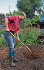 Joe Qeirolo, former garden manager at Crow Canyon Community Gardens, spreads compost on a bed to be used for growing vegetables.Photo by Charles Kennard.