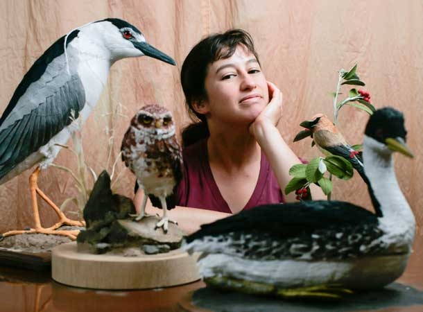 Artist Amiee Baldwin with several of her sculptures, which she calls vegan taxidermy.Photo by Tue Nam Ton, tntpictures.com.