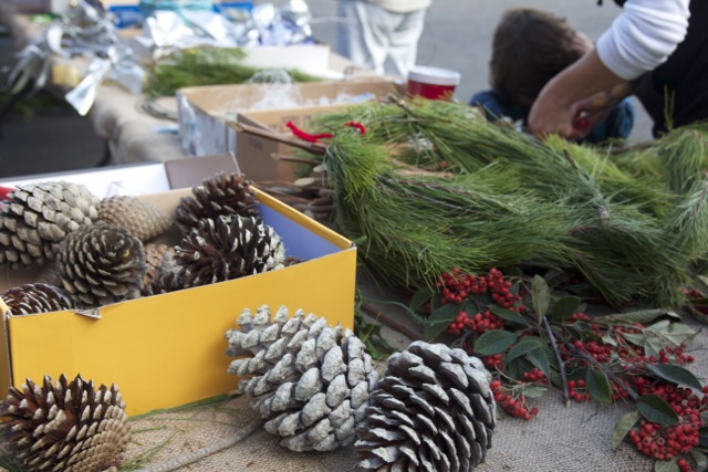 The Pacifica Land Trust set up a wreath-making station to do something with all the extra Monterey pine branches. Photo by Alison Hawkes.