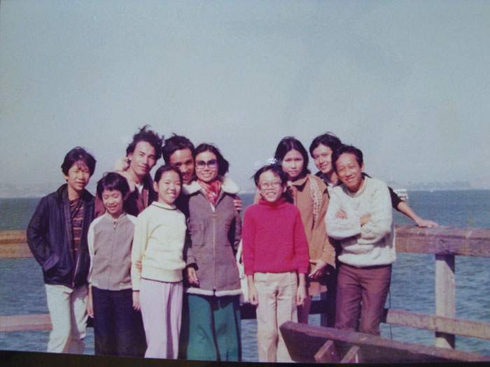 In 1976, De Tran (center in red), his siblings, uncles and aunt gather at Fisherman's Wharf for a snapshot, a year after they emigrated as refugees from Vietnam. (Photo courtesy De Tran)